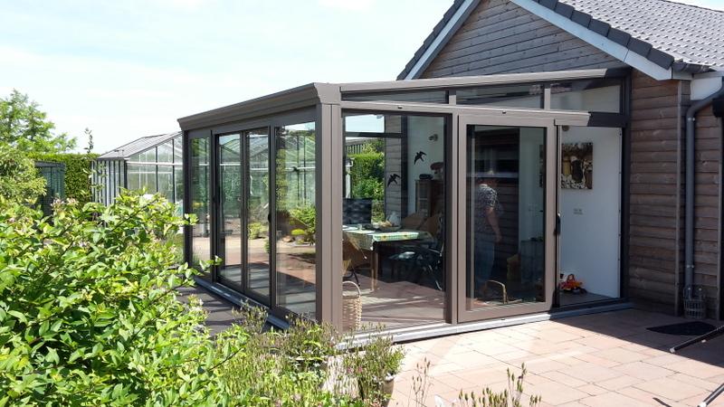 veranda met glazen dak h van den bergh essen. Black Bedroom Furniture Sets. Home Design Ideas